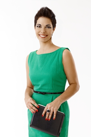 Happy young businesswoman in green dress isolated on white.
