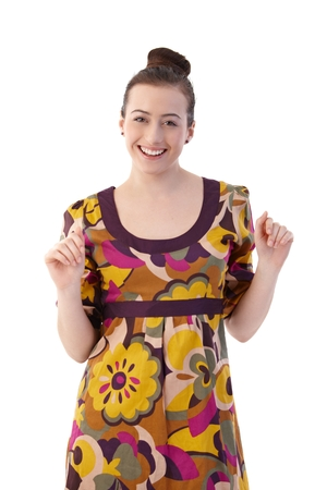Happy young woman posing in summer dress, looking at camera, smiling. Isolated on white.
