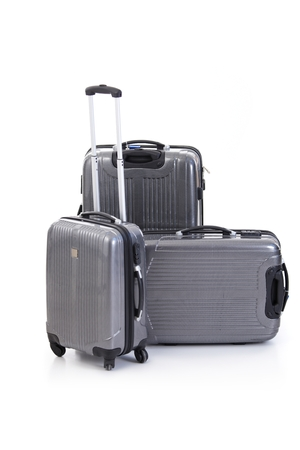 Group of gray suitcases. Isolated on white.