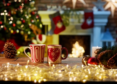 Christmas still life with mugs and fireplace - cosy winter time.
