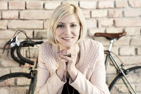Young woman smiling front of bicycle. Standard-Bild - 125784869