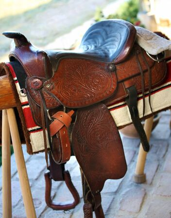 Ornamented handmade leather saddle, western style.