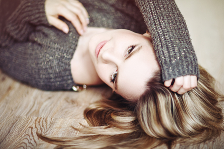 Young beautiful woman in a sweater smiling