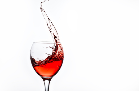 A glass with pink wine and sprays. Stock Photo