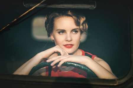 Woman in retro car Stock Photo