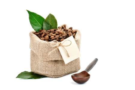Coffee beans in a bag of sackcloth on a white background with blank tag. Stock Photo
