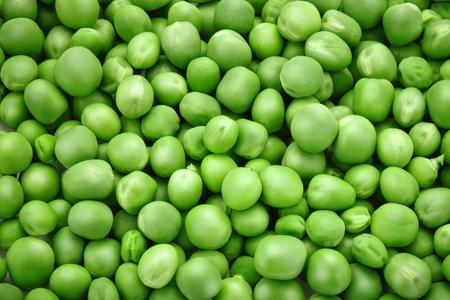 bean family: The texture of ripe green peas. Stock Photo