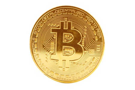 Gold coin of bitcoin on a white background. Фото со стока