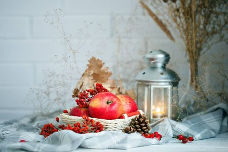 coffee harvest: Apples, berries and autumn leaves on a wooden table. Autumn background.