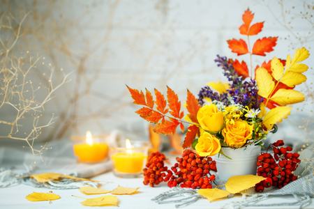 Autumn leaves and flowers on a wooden table. Autumn background with copy space. Autumn still life.