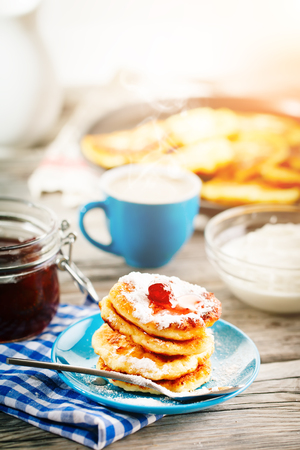 Delicious pancakes on wooden table with Cup of coffee and jam