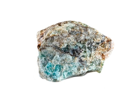 Macro shooting of natural gemstone. Raw mineral Apatite. Madagascar. Isolated object on a white background.