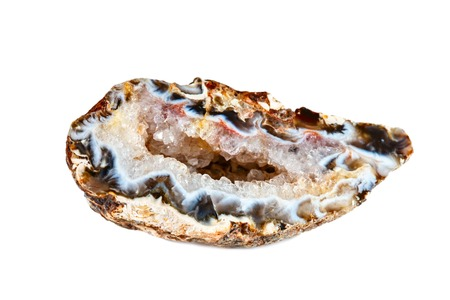 Macro shooting of natural gemstone. The raw mineral is Geode of chalcedony. Brazil. Isolated object on a white background. Foto de archivo