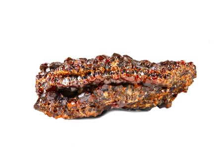 Macro shooting of natural gemstone. Raw mineral garnet andradite. Isolated object on a white background. 스톡 콘텐츠