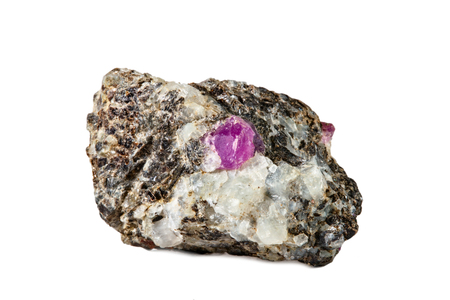 Macro shooting of natural gemstone. Raw mineral ruby in albite. Karelia. Isolated object on a white background. Imagens