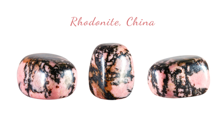 Macro shooting of natural gemstone. The raw mineral is rhodonite, China. Isolated object on a white background.