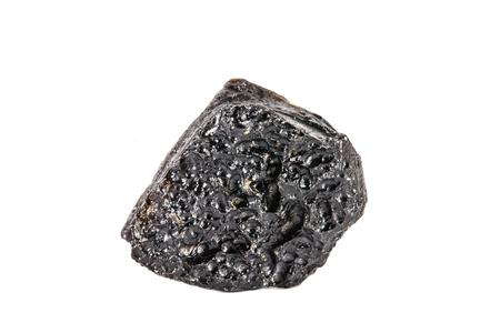 Macro shooting of natural gemstone. Raw mineral tektite, China. Isolated object on a white background. Stock Photo