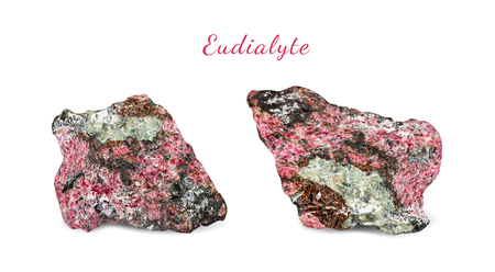 Macro shooting of natural gemstone. Natural rock specimen of eudialyte. Isolated object on a white background. Stock Photo