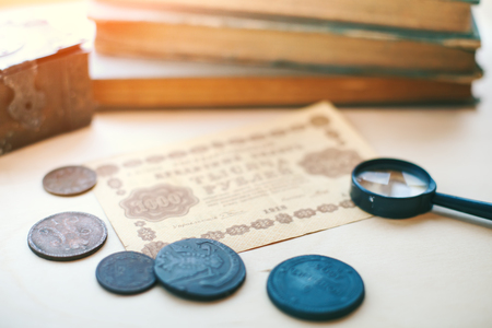 Collection of old coins and banknotes. Stock Photo