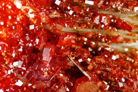 Macro shooting of natural gemstone. Texture of mineral vanadinite. Abstract background.