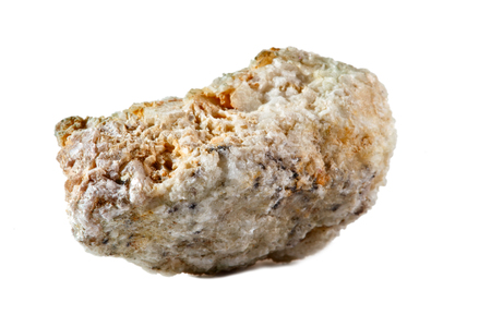Macro shooting of natural gemstone. The raw mineral is albite, Brazil. Isolated object on a white background.