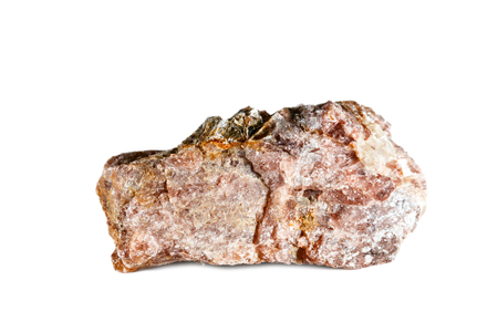 Macro shooting of natural gemstone. The raw mineral is andalusite. China. Isolated object on a white background. Stock Photo