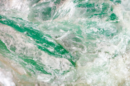 Macro shooting of natural gemstone. The raw mineral is talc . Stock Photo