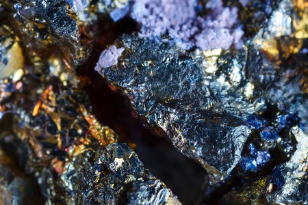 Macro shooting of natural gemstone. The raw mineral is chalcopyrite .
