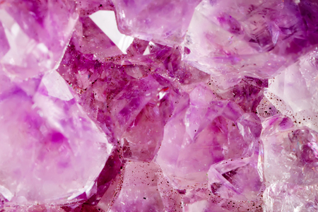 Amethyst. The texture of the mineral. Macro shooting of natural gemstone. The raw mineral. Abstract background. Stock Photo