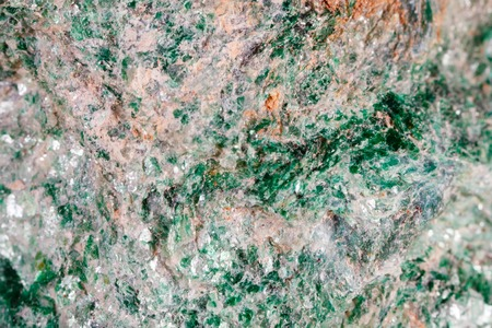 Fuksit. The texture of the mineral. Macro shooting of natural gemstone. The raw mineral. Abstract background.
