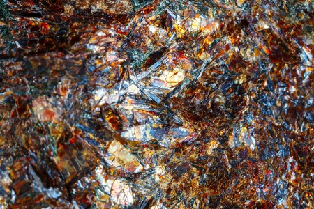 Astrofillit mineral Khibiny Mountains. The texture of the mineral. Macro shooting of natural gemstone. The raw mineral. Abstract background.