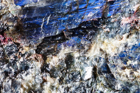 Mineral Labrador. The texture of the mineral. Macro shooting of natural gemstone. The raw mineral. Abstract background.