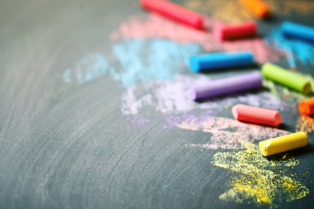 Colorful crayons on the blackboard, drawing. Back to school background. Archivio Fotografico