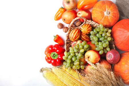 Happy Thanksgiving Day background, table decorated with Pumpkins, Maize, fruits and autumn leaves. Harvest festival. The view from the top. Horizontal. Background with copy space.