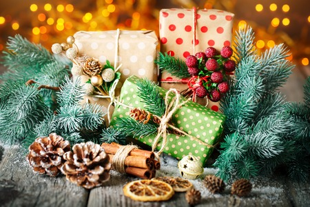 Merry Christmas and happy New year. Christmas gift and Christmas tree on dark wooden background. Selective focus. Stock Photo