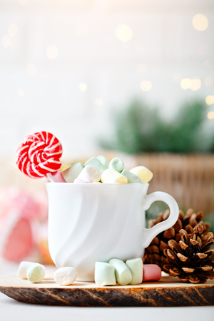 Merry Christmas and happy New year. Cup of cocoa and marshmallows on a light background. Selective focus. Christmas background. Stock Photo