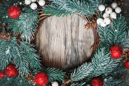 Merry Christmas and happy New year. Christmas decorative wreath on wooden background. Background with copy space. Horizontal. Selective focus. Stock Photo
