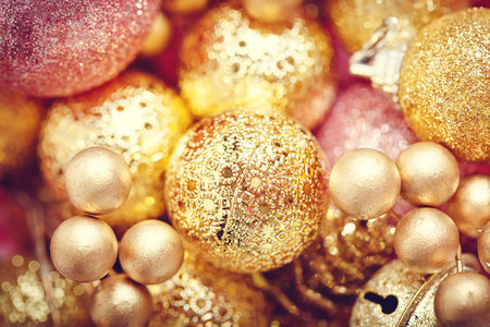 Merry Christmas and happy New year. Texture of gold Christmas toys. Christmas background.