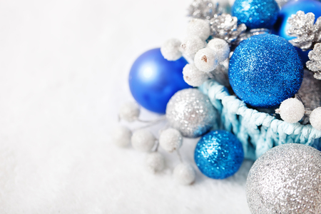 Merry Christmas and happy New year. Blue and silver Christmas toys on a light background. Selective focus. Top view. Christmas background. Background with copy space.
