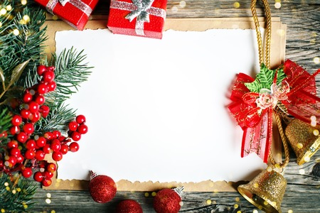 Merry Christmas and happy New year. Cup cocoa, cookies, gifts and fir-tree branches on a wooden table. Selective focus. Christmas background. Top view. Horizontal. Stock Photo