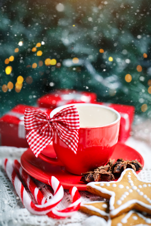 Merry Christmas and happy New year. Cup of cocoa, cookies, gifts and fir-tree branches on a white wooden table. Selective focus. Christmas background. Vertical. Background with copy space. Stock Photo