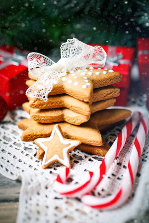 Merry Christmas and happy New year. Cookies gifts and fir tree branches on a wooden table. Selective focus. Christmas background. Stock Photo