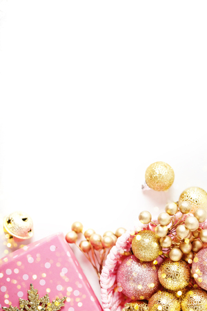 Merry Christmas and happy New year. Golden Christmas toys on a light background. Selective focus. Top view. Christmas background. Background with copy space. Stock Photo