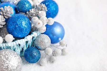 Merry Christmas and happy New year. Blue and silver Christmas toys on a light background. Selective focus. Top view. Christmas background. Horizontal. Background with copy space. Stock Photo