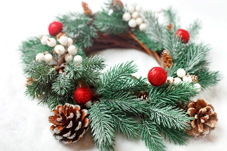 Merry Christmas and happy New year. Christmas decorative wreath on a light background. Background with copy space. Horizontal. Selective focus.