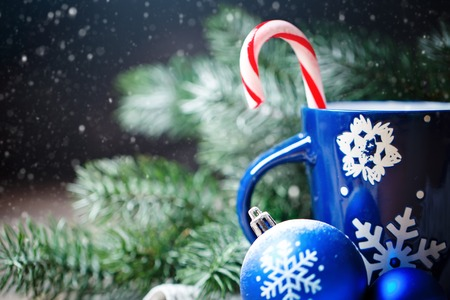 Merry Christmas and happy New year. Cup cocoa, gifts and fir-tree branches on a wooden table. Selective focus. Christmas background. Background with copy space. Horizontal. Stock Photo