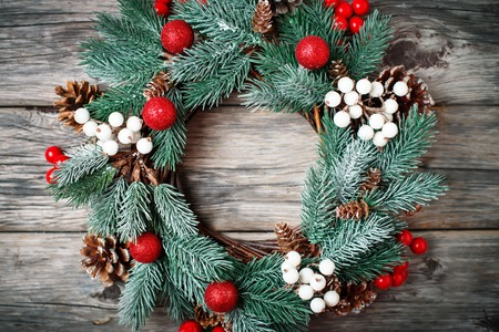 Merry Christmas and happy New year. Christmas decorative wreath on wooden background. Background with copy space. Horizontal. Selective focus. Top view.