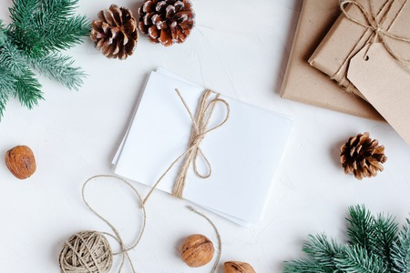 Merry Christmas and happy New year. Christmas gifts on light background. Selective focus. Top view. Christmas background. Horizontal. Stock Photo