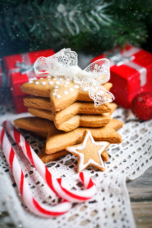 Merry Christmas and happy New year. Cookies gifts and fir tree branches on a wooden table. Selective focus. Christmas background. Vertical. Stock Photo