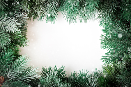 Merry Christmas and happy New year.A frame of fir-tree branches on a white background. Selective focus. Christmas background. Horizontal. Background with copy space. Top view.